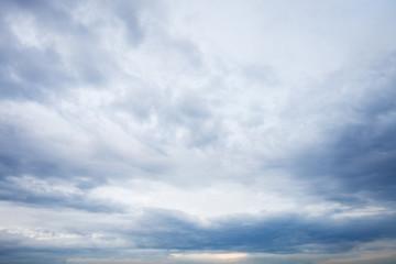 Spoed Fotobehang Hemel grey blue clouds in evening sky