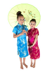 two beautiful girls wearing Asian dresses under umbrella