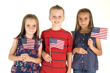 Three cute children holding Ameican flags happy