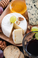 Assorted delicatessen appetizers - cheese, grapes, crackers