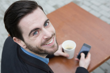 Guy with coffee and mobile phone