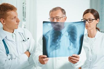 Doctors examine x-ray image