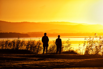 Romantic couple take a sunset walk