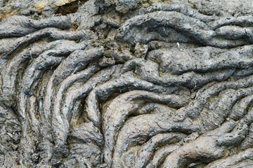 Textures of black lava (pahoehoe) in Santiago island