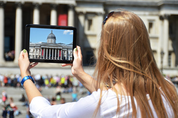 The National Gallery on the screen of a  tablet. Trafalgar squar