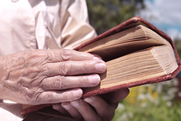 book in a hand