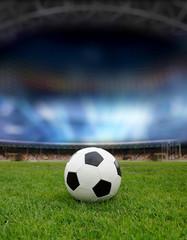 Soccer ball on the field of stadium