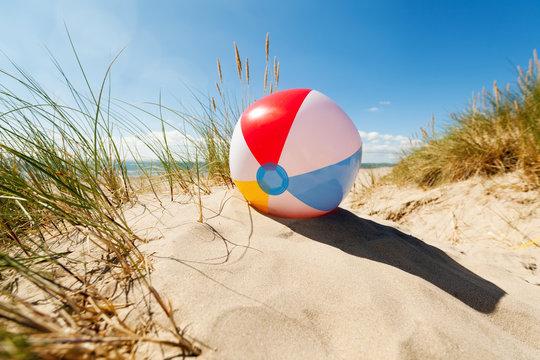Beach ball in sand dune