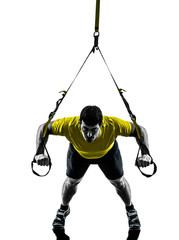 Wall Mural - man exercising suspension training  trx silhouette