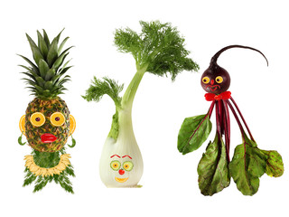 Funny portraits made from beet , fennel and pineapple