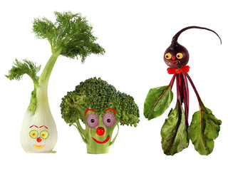 Funny portraits made from beet , fennel and broccoli