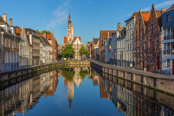 Brugge - Canal and  the Burghers lodge building in morning