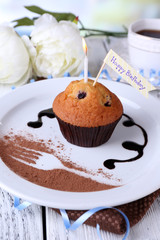 Blueberry muffin with chocolate sauce