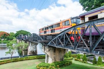 Train on the bridge over river Kwai in Kanchanaburi, Thailand