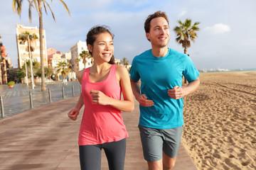 Running couple jogging Barcelona Beach Barceloneta
