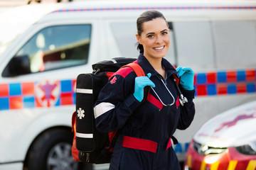 female paramedic carrying lifepack