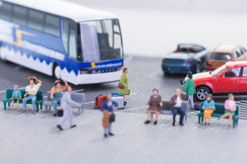 Miniature travellers at a bus station