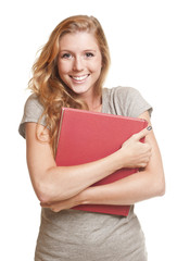 Young woman holding red book