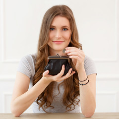 Attractive girl with wallet