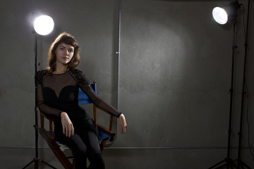 young female actress sitting on a directors chair