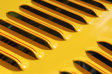 Wall Mural - yellow vehicle engine grille closeup