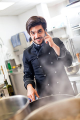 Chef taking a call on his smartphone