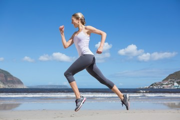 Self adhesive Wall Murals Jogging Pretty fit blonde jogging on the beach