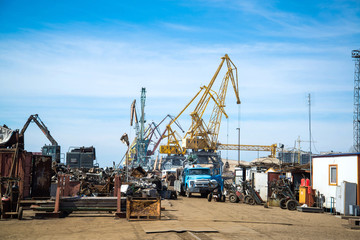 Cranes and junk in port