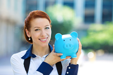 Happy woman, corporate employee holding piggy bank
