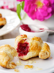 Homemade croissants with rose jam