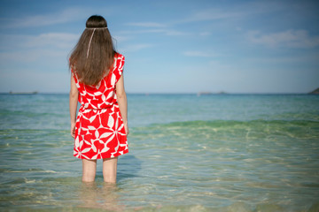 Young pretty woman in red near the sea