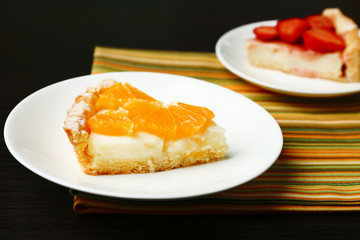 Piece of homemade orange and strawberry tarts