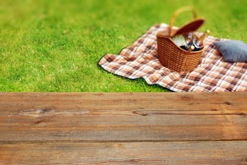 Aluminium Prints Picnic Picnic table, blanket and basket in the grass