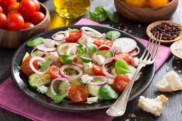 vegetable salad with feta cheese on a plate