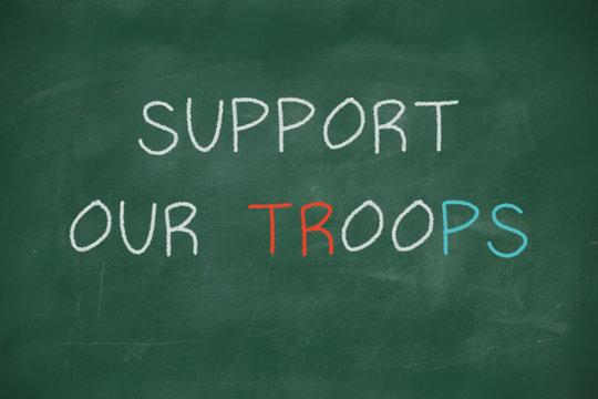 Support our troops handwritten on blackboard
