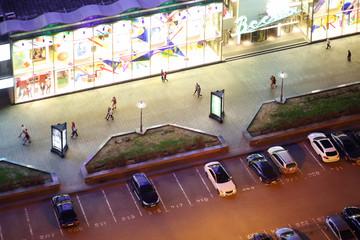 People walk on New Arbat Street at night