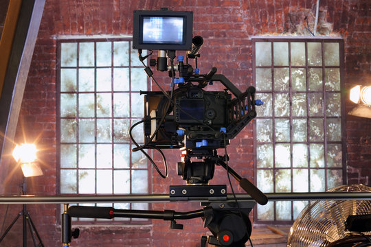 Camera with special devices for shooting video on rail in studio