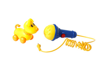 Two plastic toys. Dog and microphone.
