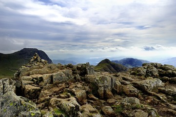 Cairn on Pike of Stickle to the rest of the Langdales