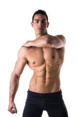 Handsome muscular shirtless young man looking at camera