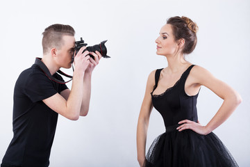 Man shooting a photo of elegant dancer