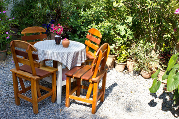 able and chairs in garden