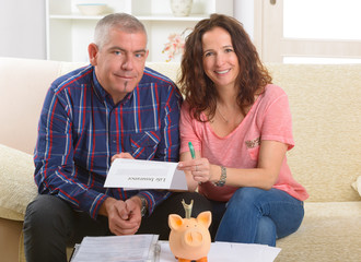 Couple signing life insurance contract