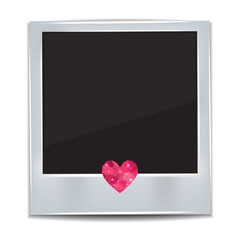 Photo frame with heart on white background.