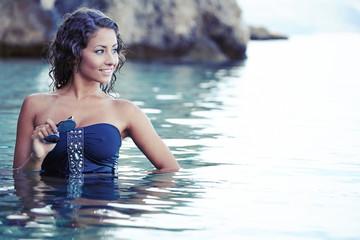 Beautiful girl in bikini swimming in sea