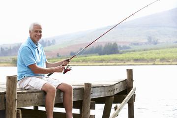 Printed kitchen splashbacks Fishing Senior man fishing on jetty