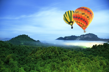 Colorful hot-air balloons flying over the mountain