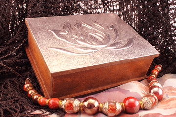 Silver box and red necklace