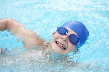 Boy swimming in outdoor pool
