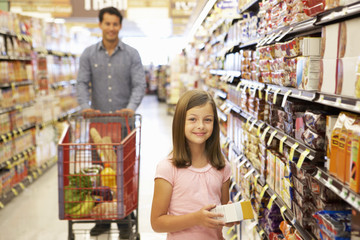 Father and daughter shopping in supermarket